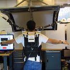 Supernumerary Robotic Limbs